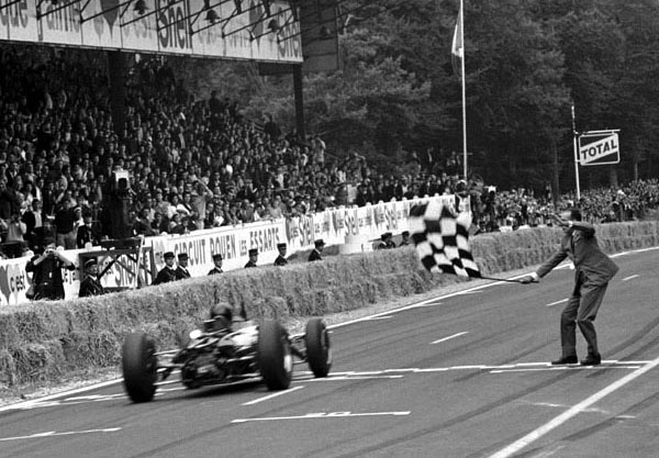 French GP, Rouen 28 June 1964 Winner Dan Gurney, Brabham BT7 takes the flag
