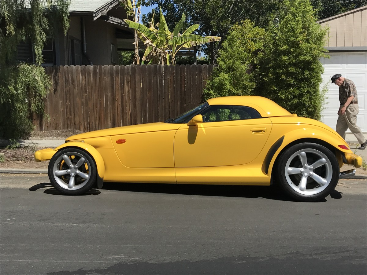this featured example boasts non factory body colored bumpers hardtop and chrome grille