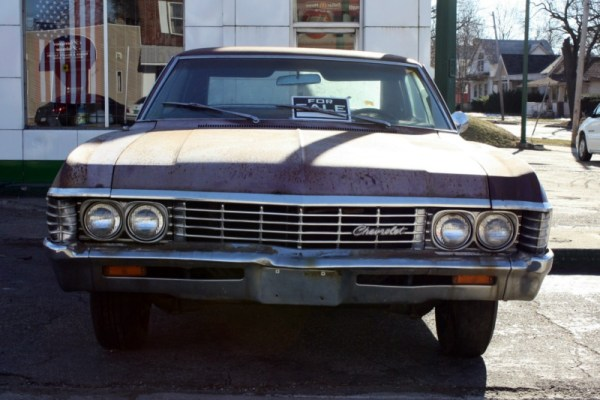 Dreams for sale. 1967 Chevrolet Impala hardtop sedan, with American flag in the window of Severance Service.