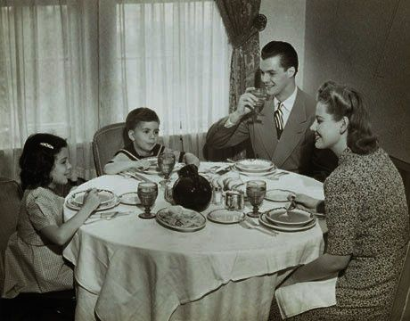 A 1950's family enjoying a meal together