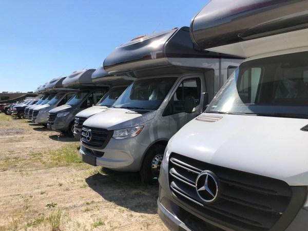 a row of new Mercedes Sprinter RV's