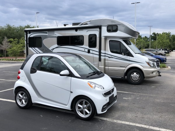 a smart and an RV at CarMax