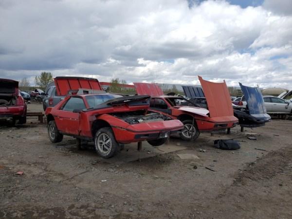 Pontiac Fieros in a scrapyard