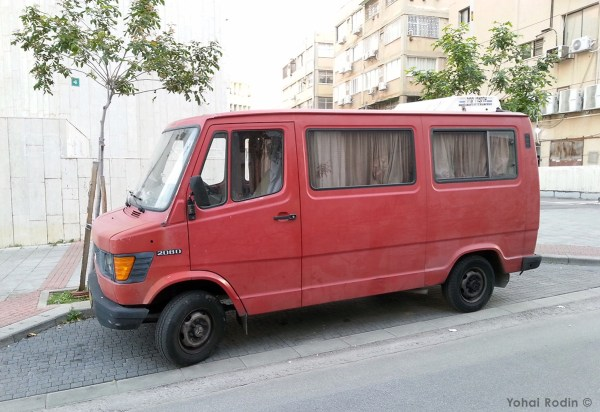 Red Mercedes-Benz 208D