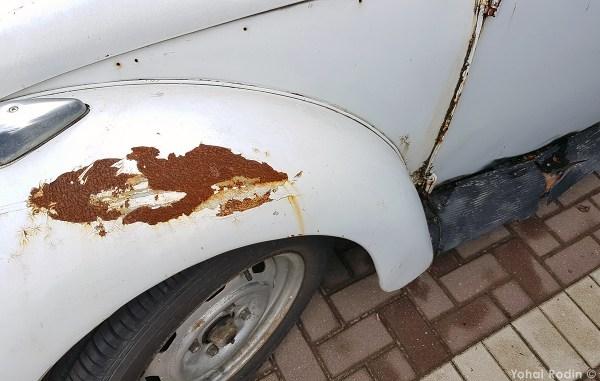 White Volkswagen Beetle Rust