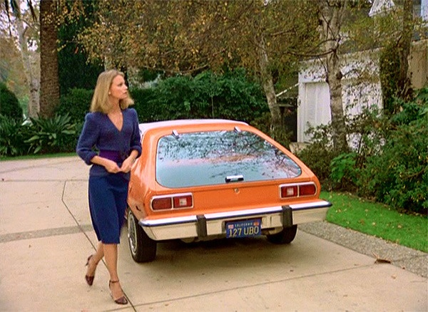 Tiffany Welles with the orange 1977 Ford Pinto.