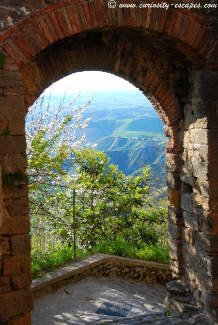 arch in Volterra with a view on Tuscany