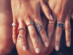 female wearing rings in all fingers