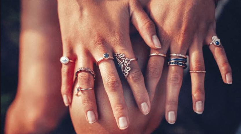 female wearing rings in all fingers