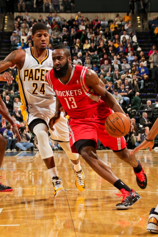 INDIANAPOLIS, IN - JANUARY 18: James Harden #13 of the Houston Rockets drives ahead of Paul George #24 of the Indiana Pacers on January 18, 2013 at Bankers Life Fieldhouse in Indianapolis, Indiana.  NOTE TO USER: User expressly acknowledges and agrees that, by downloading and or using this photograph, user is consenting to the terms and condition of the Getty Images License Agreement. Mandatory Copyright Notice: 2013 NBAE  (Photo by Ron Hoskins/NBAE via Getty Images)