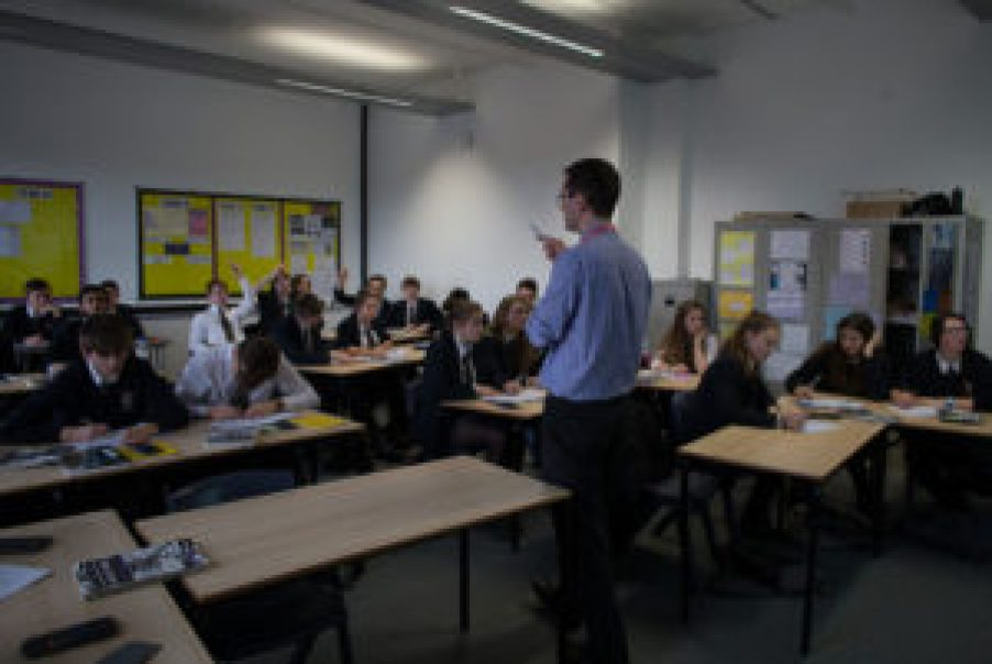 BRISTOL, UNITED KINGDOM - FEBRUARY 26: A teacher talks to pupils during a maths lesson at the Ridings Federation Winterbourne International Academy in Winterbourne near Bristol on February 26, 2015 in South Gloucestershire, England. Education, along with National Health Service and the economy are likely to be key election issues in the forthcoming general election in May. (Photo by Matt Cardy/Getty Images)