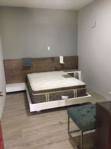 Modern queen bed with shelves and table