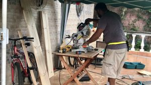 Andres Zamora working with a table saw