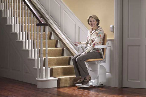 stair lift chair tufted high back lafayette in stairlifts chairlifts home elevators lady at stairs