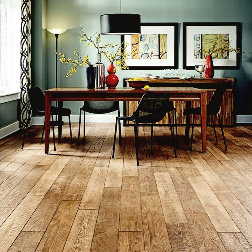 Mannington historic oak laminate gives this dining room rustic flare.
