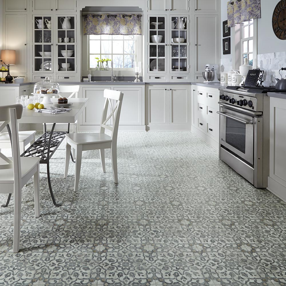 A traditional floral motif with a time worn appearance and sleek color palette.