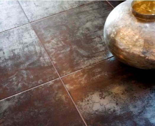 A metallic overlay adds depth to this bronze large format tile. (Available at Custom Home Interiors)