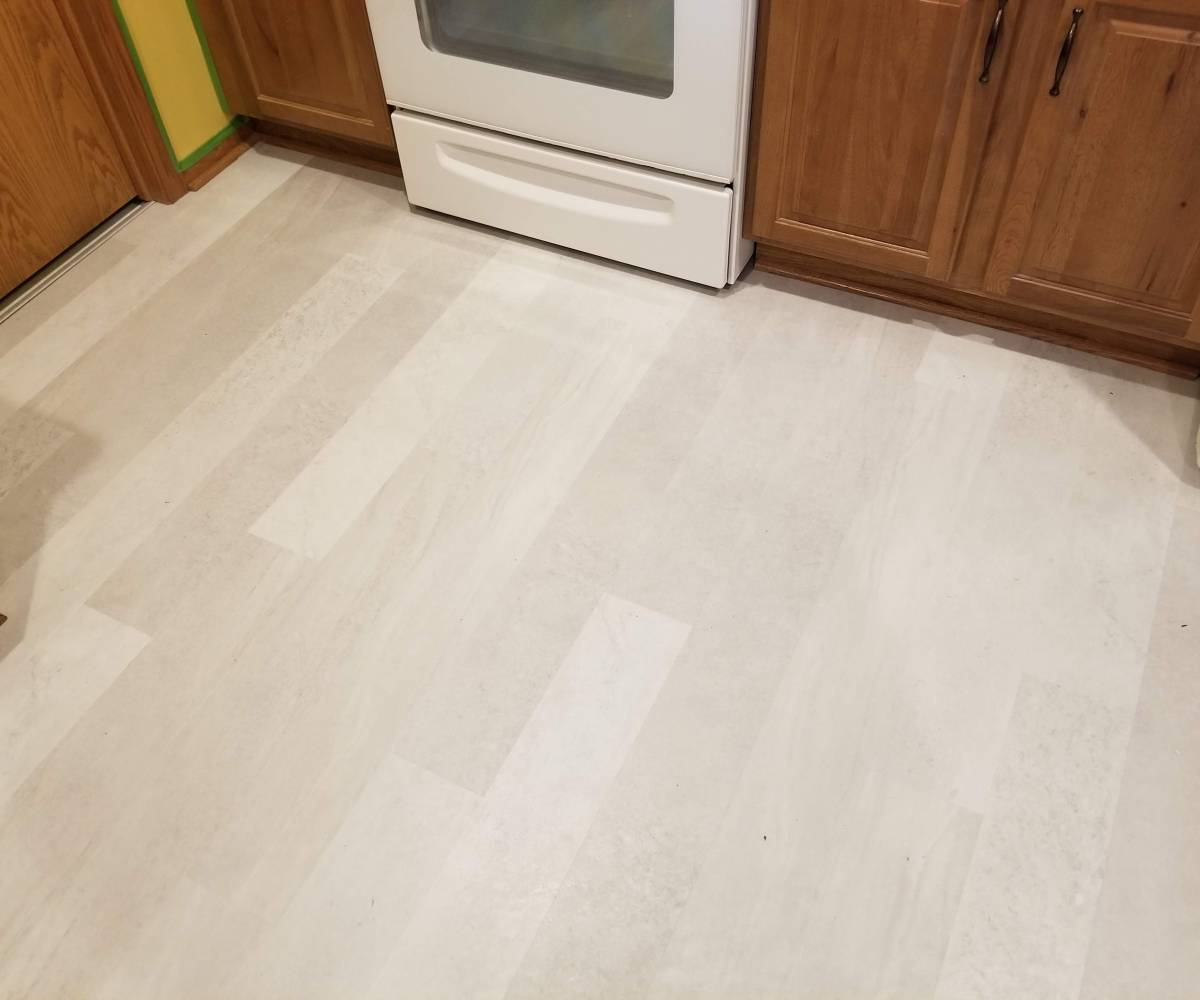 Mannington Adura Max Meridian Stucco luxury vinyl planks.