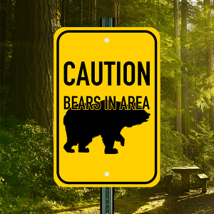 Yellow Sign w/ Black Text & Image of Bear