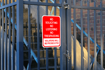 Red Tall Loitering Soliciting Trespassing Sign