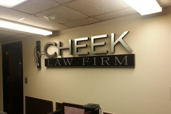 The lobby logo sign for Cheek Law Firm after installation.