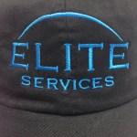 Close up image of Elite Services logo on baseball cap