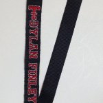 black lanyard with embroidered Texas Tech Logo and Dylan Finley
