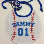 embroidery of name and age on baseball shapped bib