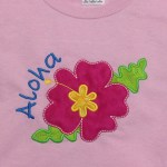 bright pink hibiscus flower for aloha party on pink tshirt