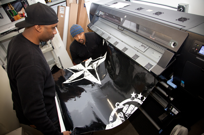 After the designing process is finished the wrap is printed out in five foot sections at Custom Vehicle Wraps, Photo by Lori Eanes for the Wall Street Journal.