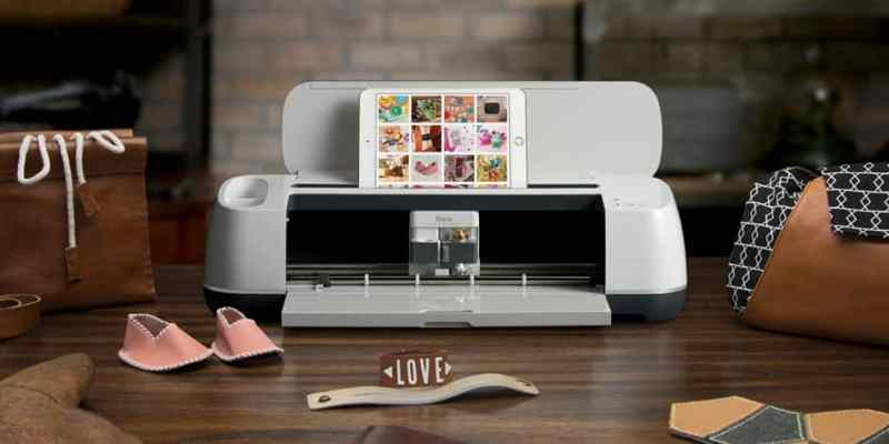 A Cricut maker sits on a table among a variety of creations.