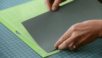 Loading cardstock on to a cutting mat