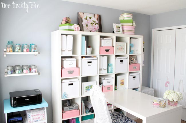 Delicate pinks and blues coordinate with the white furniture