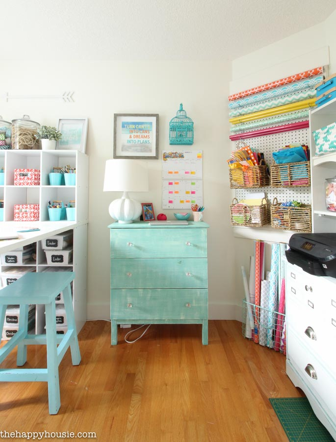 Well-organized crafts in cubbies and pegboard