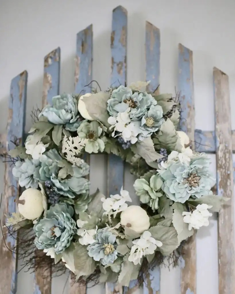 Fall wreath hung on blue vintage gate
