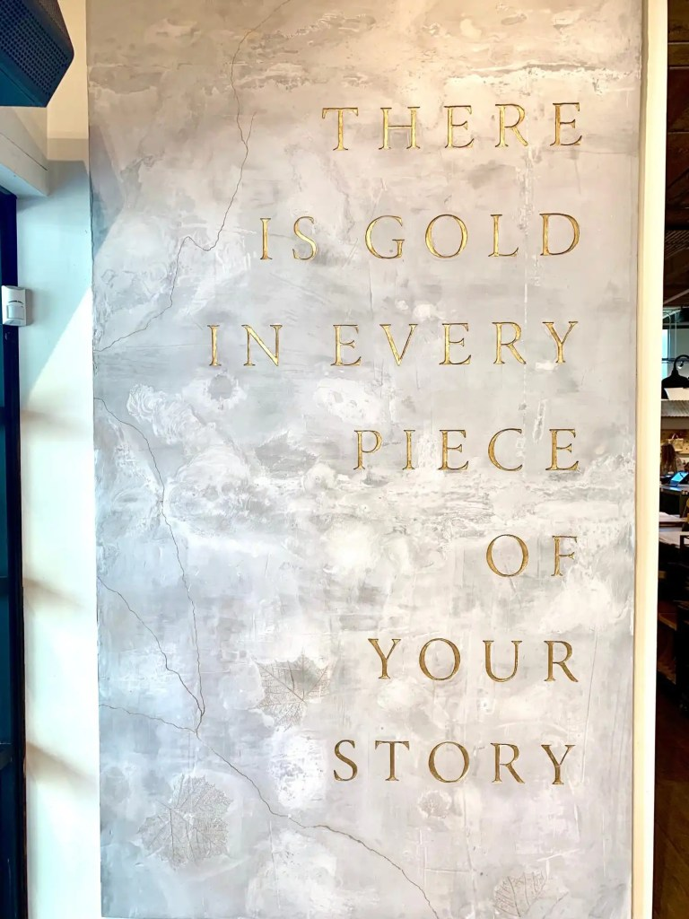 """Joanna Gaines' sign reads 'There is gold in every piece of your story"""""""
