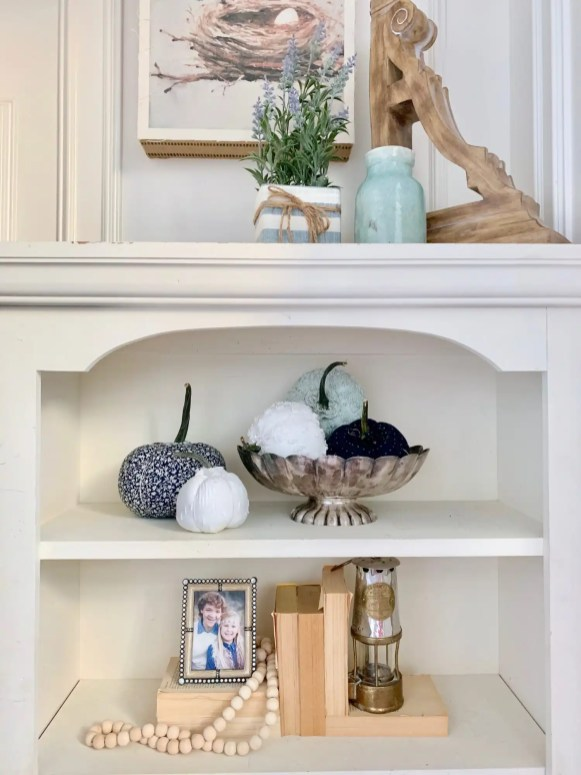 formal bookshelf styling with fabric pumpkins