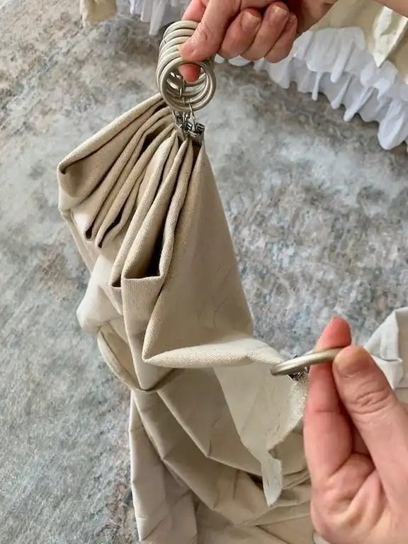 fold the curtain between each ring
