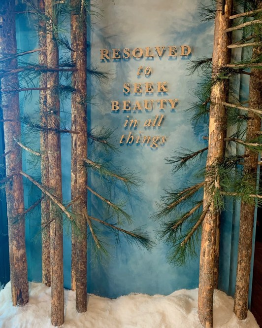 The entrance of Magnolia Market includes real pine trees and piles of faux snow.
