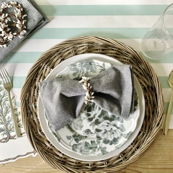 DIY Napkin rings placed on place setting for Christmas