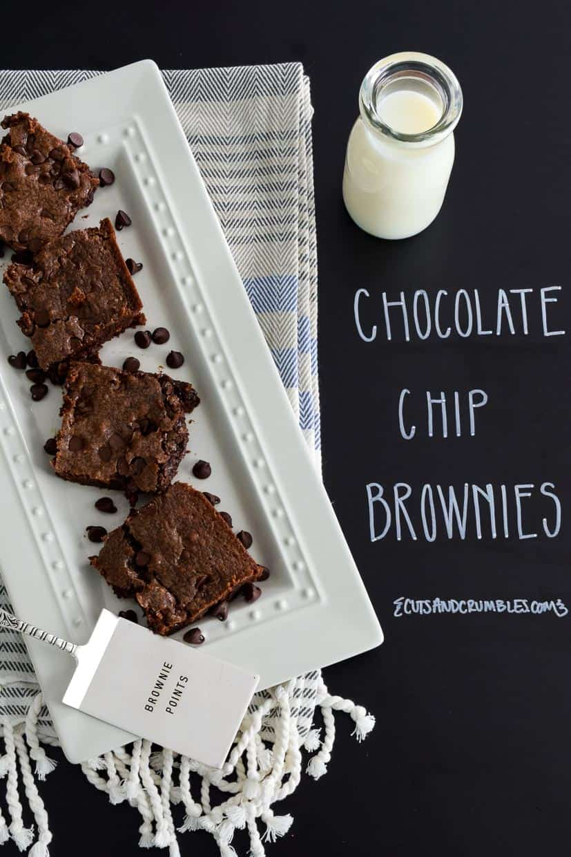 Chocolate Chip Brownies on white platter with title written on chalkboard