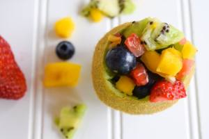 tropical fruit salad in kiwi cups old image
