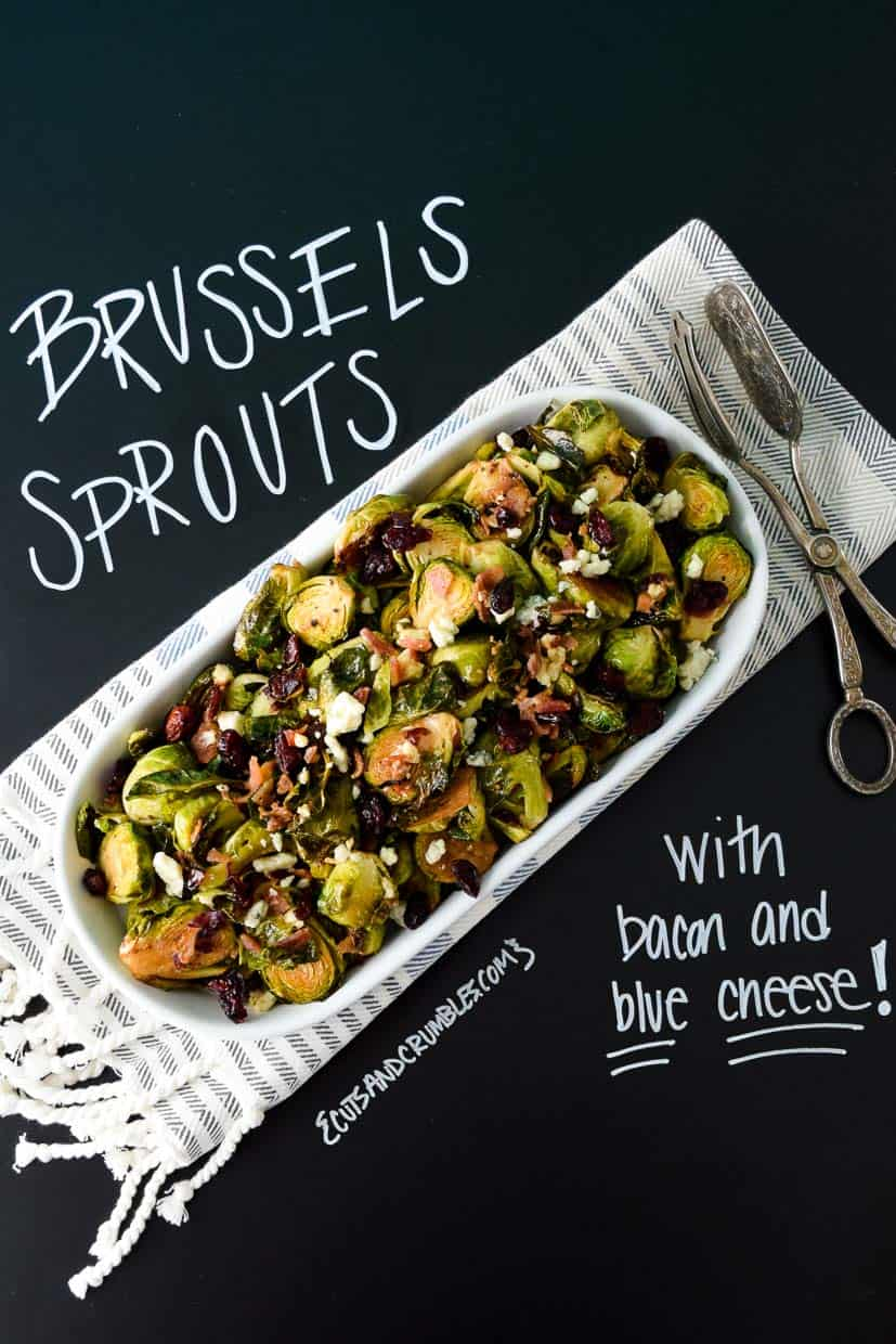 Brussels Sprouts with Bacon and Blue Cheese on platter with title written on chalkboard