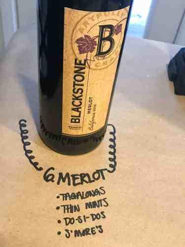 bottle of merlot on brown paper with cookie pairings written underneath