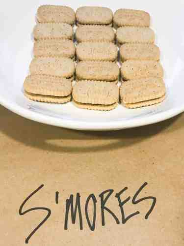 Girl Scout cookie s'mores on white platter