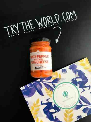 Jar of spicy pepper paste with feta cheese with try the world card beside it