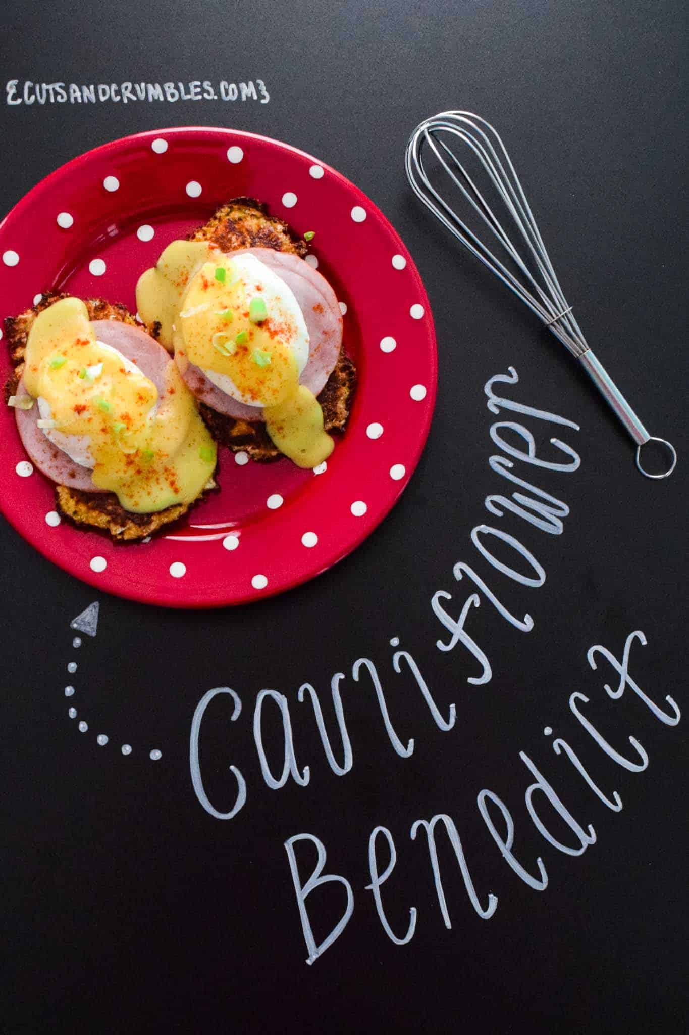 cauliflower benedict on red plate with title written on chalkboard