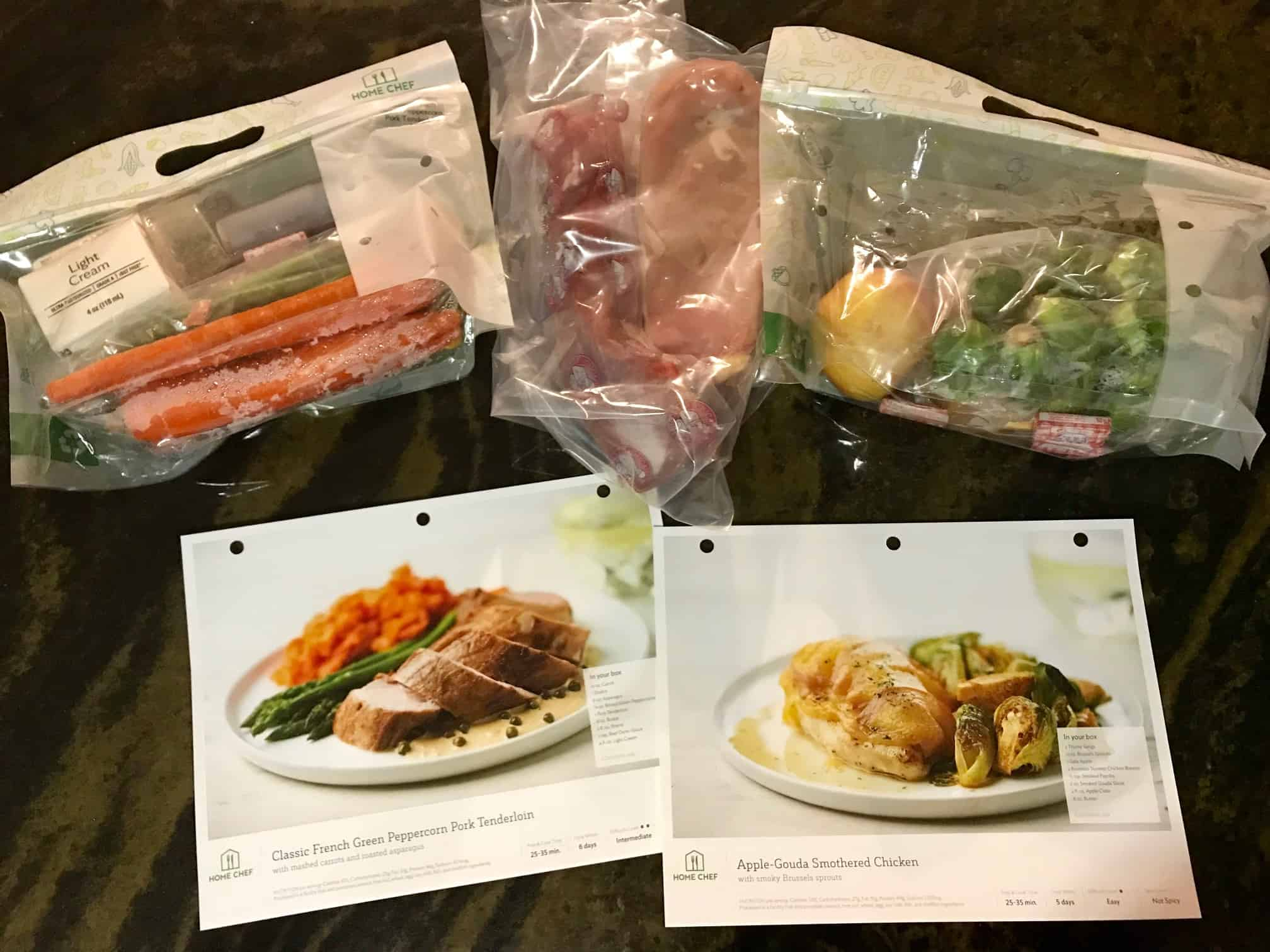 Home Chef Meals in bags with recipe cards in front