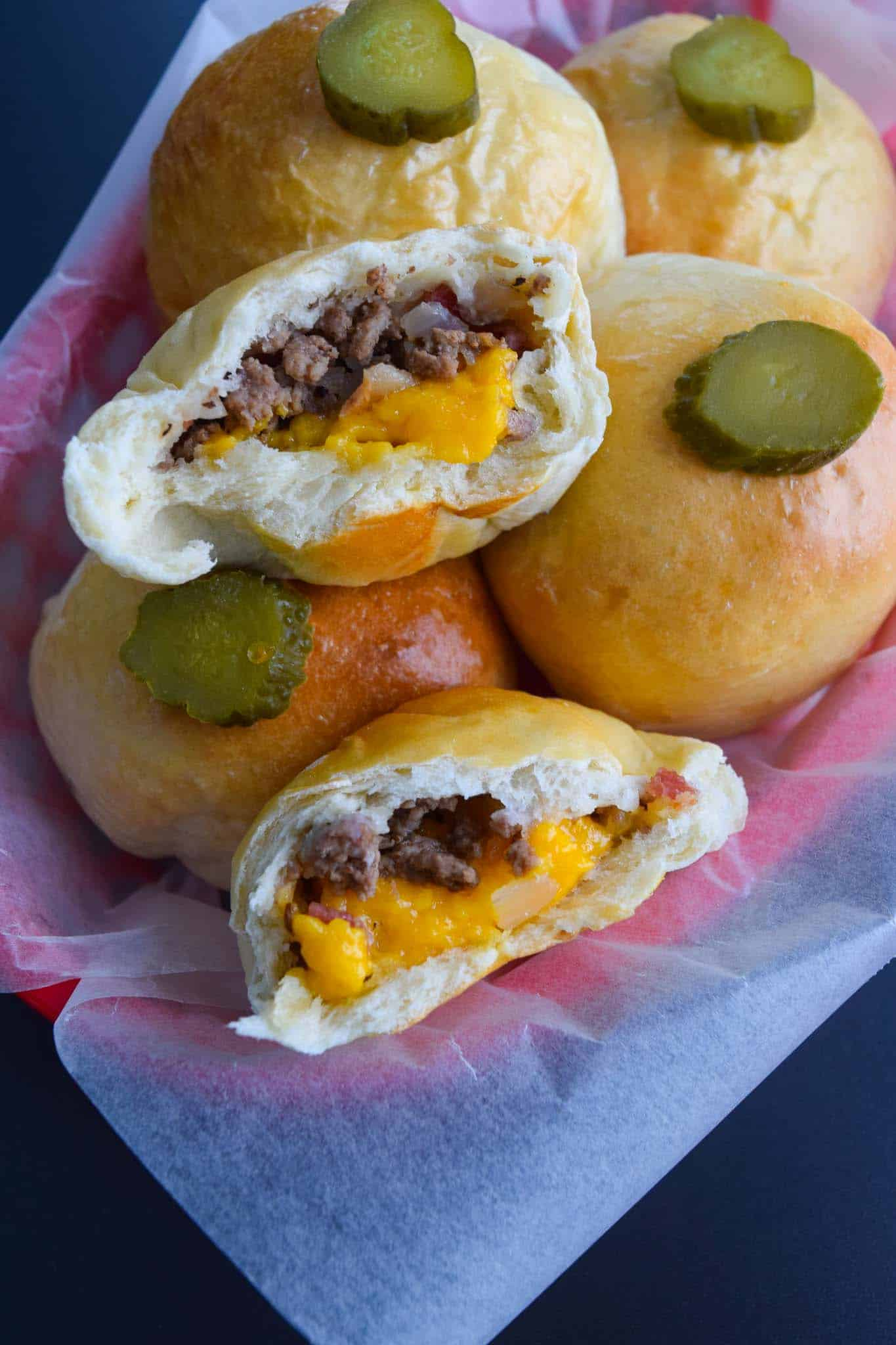 Bacon Cheeseburger Bombs cut in half to show cheesy inside close up view