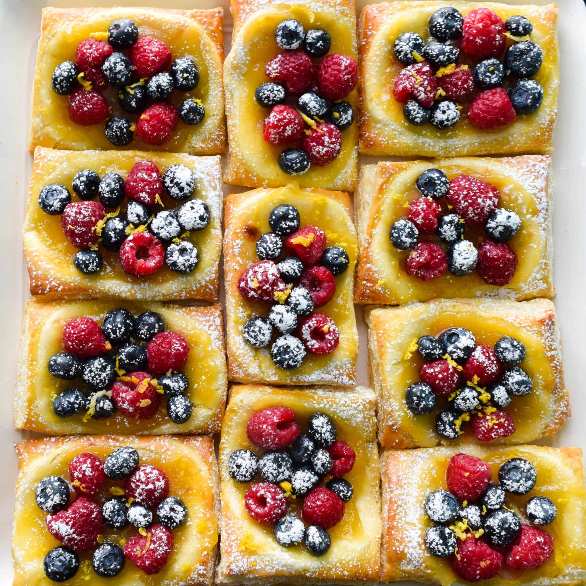 Lemon and Berry Cheesecake Puffs on serving tray overhead shot